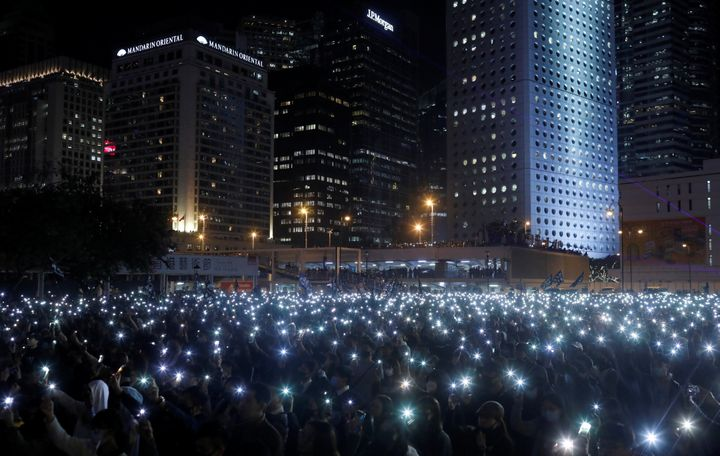 A photo taken by journalist Danish Siddiqui captures anti-government protesters as they hold up their mobile phones during a