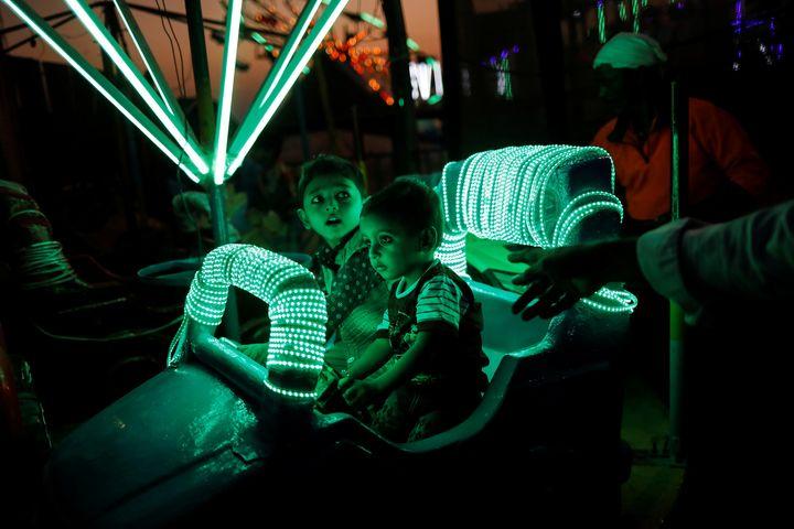 Photographer Danish Siddiqui capture children enjoying a ride at a fair in Mumbai, India, December 27, 2018. REUTERS/Danish S