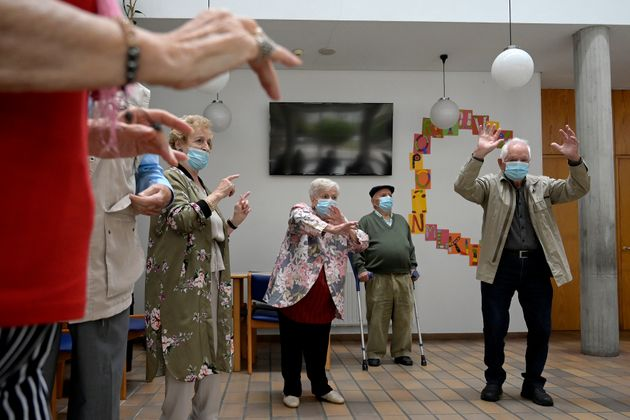 Several residents dance in a senior center in