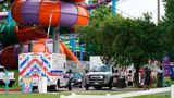 Emergency vehicles are seen near where people were treated for chemical irritants at Six Flags Hurricane Harbor Splashtown on Saturday.