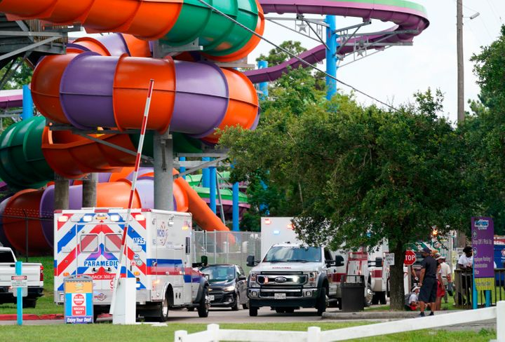 Emergency vehicles are seen near where people were treated for chemical irritants at Six Flags Hurricane Harbor Splashtown on