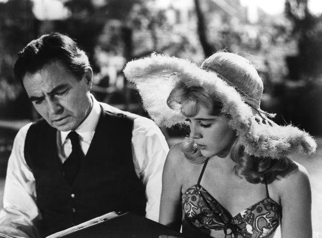 British actor James Mason and American actress Sue Lyon on the set of his movie Lolita, based on the novel by Vladimir Nabokov and directed by Stanley Kubrick. (Photo by Seven Arts Production/Sunset Boulevard/Corbis via Getty Images)