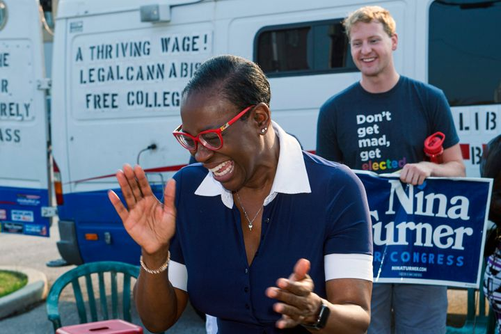 Nina Turner speaks with supporters before casting her vote in Cleveland on July 7. Turner, a progressive firebrand, is emphas