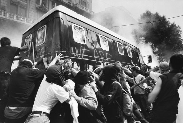 GENOA, ITALY - JULY: (FRANCE OUT) Protesters attack an Italian police vehicle during protests against the 27th Group of Eight Summit in July, 2001 in Genoa, Italy. Hundreds of thousands of protesters gathered between July 18 and 22 in Genoa to participate in demonstrations against the meeting of the G8 nations. Ensuing clashes with police resulted in many injuries, arrests and the death of 23-year-old demonstrator Carlo Giuliani on July 20, 2001. (Photo by Paul BLACKMORE/RAPHO/Gamma-Rapho via Getty Images)