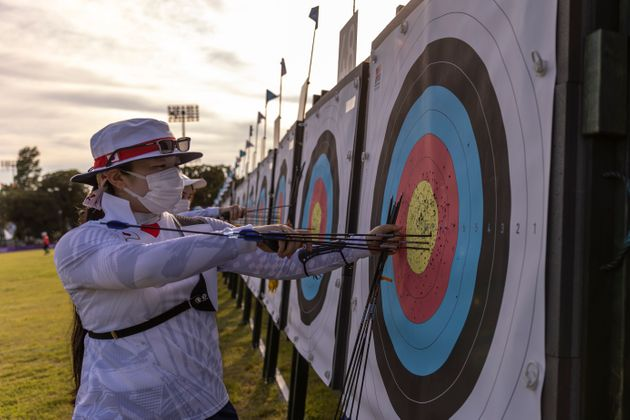 TOKYO, JAPAN - JULY 20: Athletes of Team Japan retreive arrows from the board during Archery practice...