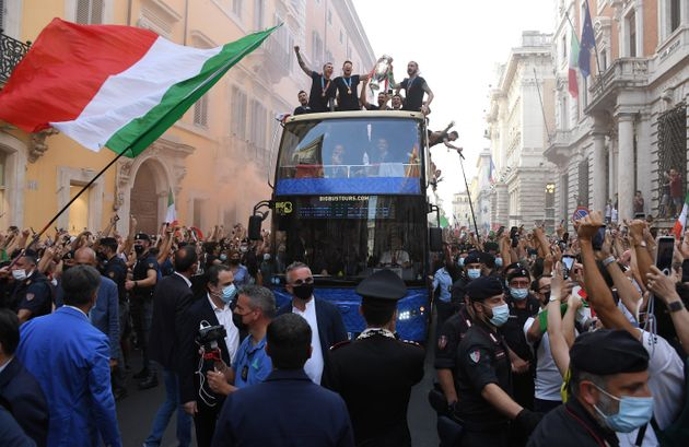 Players of Italy celebrate with fans in Rome, Italy, July 12, 2021. Italy won the final against England...