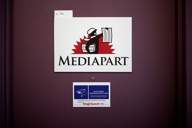 The logo of the free and independent online media outlet Mediapart is seen on a door at their office in Paris, France, March 12, 2019. REUTERS/Benoit Tessier