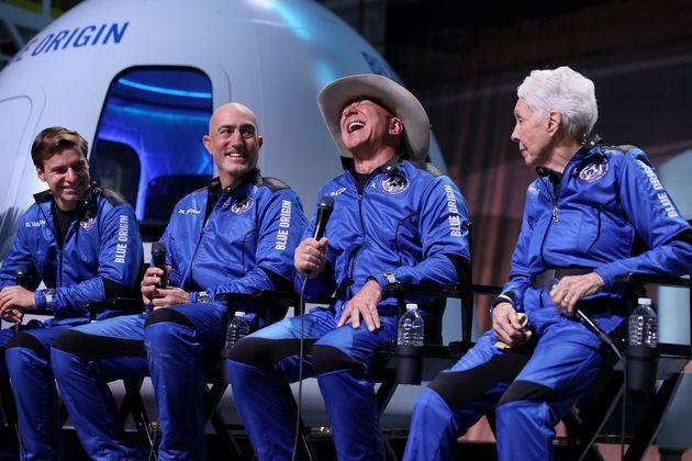Blue Origin's New Shepard crew (L-R) Oliver Daemen, Mark Bezos, Jeff Bezos, and Wally Funk hold...