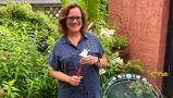 """Elizabeth Licata, moderator of the Facebook group, WNY Gardeners, poses for a photograph on July 8, 2021 in Buffalo, N.Y. Moderating a Facebook gardening group is not without challenges. Facebook's algorithms sometimes flag the word """" hoe"""" as """"violating community standards,"""" apparently referring to a different word, one without an """"e"""" at the end that is nonetheless often misspelled as the garden tool. Licata said it has been futile trying to reach Facebook to correct the mistake. (Elizabeth Licata via AP)"""