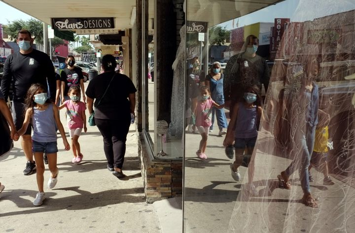 Shoppers are seen wearing masks in downtown McAllen, Texas, on July 16. Much of the worsening problem with cases is being dri