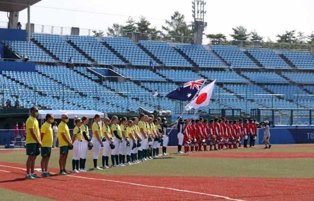 epa09355765 Team Japan and Team Australia players stand during national anthems prior to the start of...