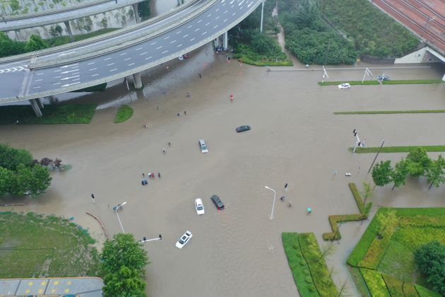 ZHENGZHOU, CHINA - JULY 20: Aerial view of vehicles stranded in floodwater on July 20, 2021 in Zhengzhou,...
