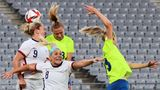 TOPSHOT - (From L) USA's midfielder Lindsey Horan, Sweden's forward Fridolina Rolfo (Rear), USA's midfielder Julie Ertz and Sweden's defender Amanda Ilestedt go for a header during the Tokyo 2020 Olympic Games women's group G first round football match between Sweden and USA at the Tokyo Stadium in Tokyo on July 21, 2021. (Photo by Yoshikazu TSUNO / AFP) (Photo by YOSHIKAZU TSUNO/AFP via Getty Images)