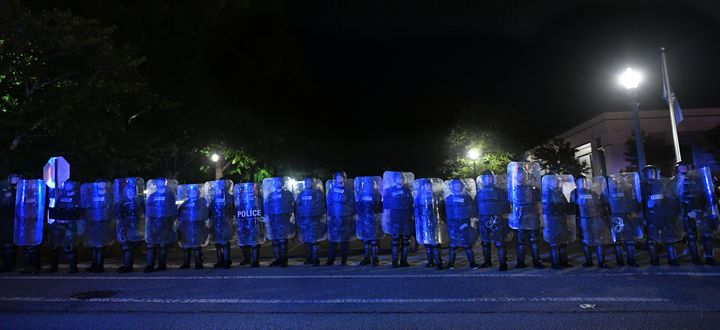 Police officers stand guard during a protest against police brutality in Rock Hill on June 24. Video showed an officer attack