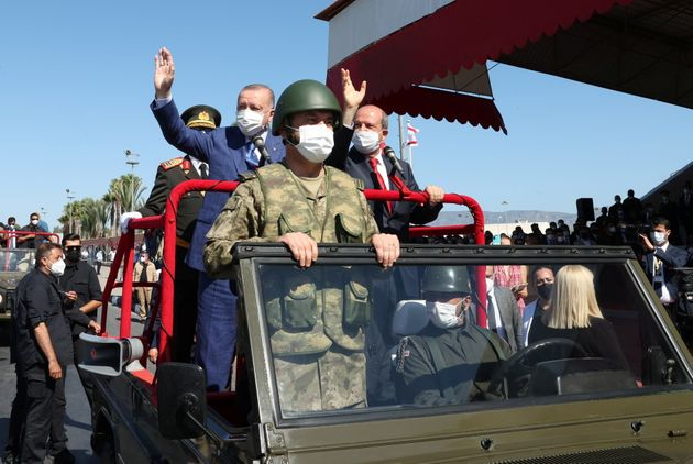 Turkish President Tayyip Erdogan and Turkish Cypriot leader Ersin Tatar attend a military parade during...