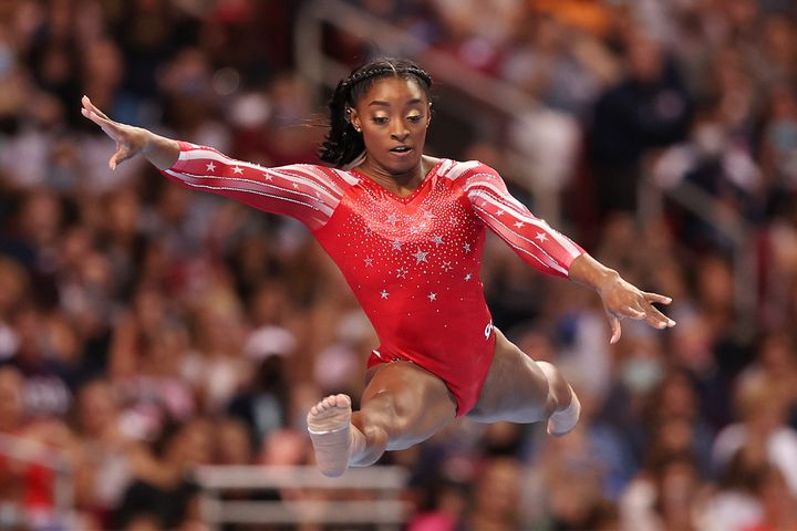 Simone Biles competes in the floor exercise during the women's competition of the 2021 U.S. Gymnastics Olympic Trials at Amer