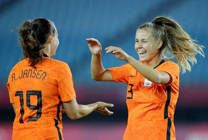 RIFU, MIYAGI, JAPAN - JULY 21: Victoria Pelova #13 of Team Netherlands celebrates with teammate Renate Jansen #19 after scoring their side's tenth goal during the Women's First Round Group F match between Zambia and Netherlands during the Tokyo 2020 Olympic Games at Miyagi Stadium on July 21, 2021 in Rifu, Miyagi, Japan. (Photo by Koki Nagahama/Getty Images)