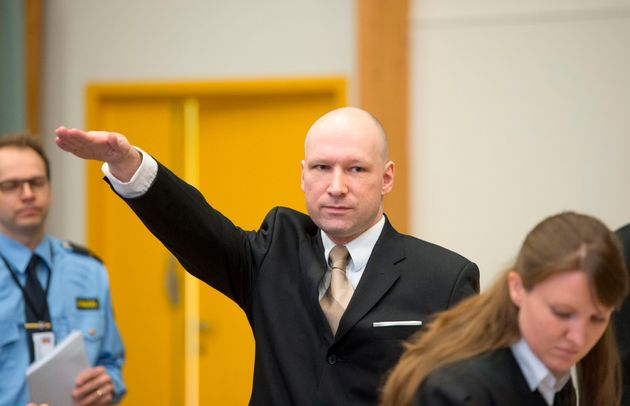 Anders Behring Breivik makes a Nazi salute as he arrives to a makeshift court in Skien prisons gym on...