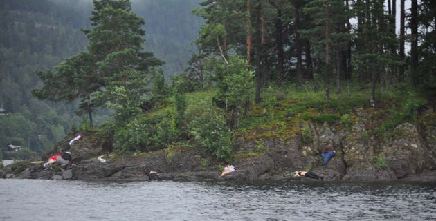UTOYA ISLAND, NORWAY - JULY 22: (NORWAY OUT) Victims lie on the banks following terror shootings at a...
