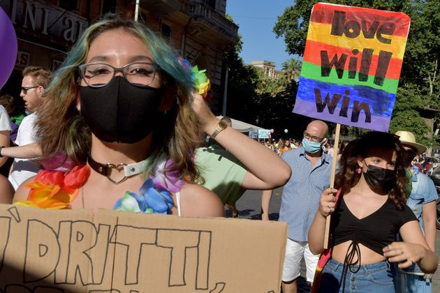 ROME, ITALY - JUNE 26: People with a sign saying Love will Win, take part in Rome Pride, the LGBTQIA+...