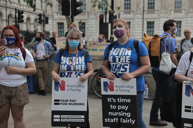 Nurses hold placards demanding for fair pay during the demonstration on the weekend of the 73rd anniversary...