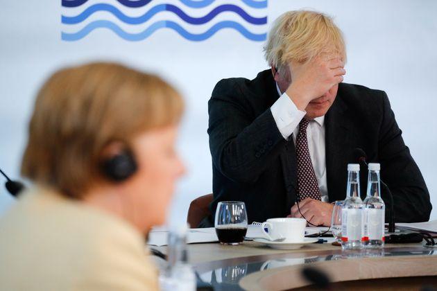 El primer ministro británico, Boris Johnson, y la canciller alemana, Angela
