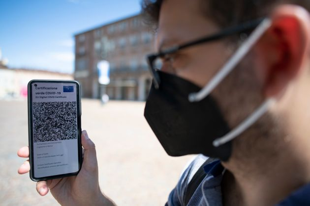 TURIN, ITALY - JUNE 30: A man shows Italy's Covid-19 Green Pass for post-vaccine travel on a smartphone on June 30, 2021 in Turin, Italy. The digital health certificate, or Green Pass, was officially launched by Italian Prime Minister Draghi, allowing people to access certain events and facilities in Italy as well as travel domestically and abroad. (Photo by Stefano Guidi/Getty Images)