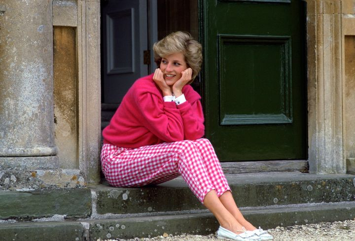 Princess Diana wears pink gingham trousers at home in Highgrove in July 1986.