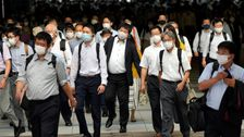 Tokyo New Virus Cases Near 2,000 A Day Before Olympics Open
