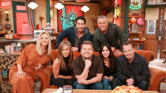 The cast of Friends posing with James