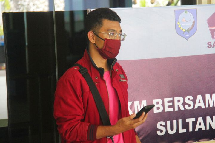In this July 18, 2021, photo, a man who used a fake identity arrives at the Sultan Babullah airport in Ternate, Indonesia. Th