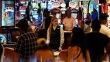 Crowds walk through the Resorts World Las Vegas casino during its opening night last month. Elected officials in tourism-dependent Las Vegas are worried about public health and the economic effects of a spike in COVID-19 cases, particularly involving the highly contagious delta variant.