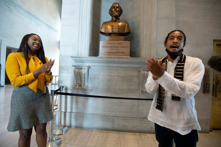 State Rep. London Lamar, left, sings with activist Justin Jones in front of the Nathan Bedford Forrest bust in the State Capitol Thursday, July 22, 2021, in Nashville, Tenn. (George Walker IV/The Tennessean via AP)