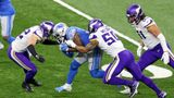 Detroit Lions running back D'Andre Swift (32) is tackled by Minnesota Vikings strong safety Harrison Smith (22) and Minnesota Vikings outside linebacker Eric Wilson (50) during the second half of an NFL football game between the Detroit Lions and the Minnesota Vikings in Detroit, Michigan USA, on Sunday, January 3, 2021. (Photo by Amy Lemus/NurPhoto via Getty Images)