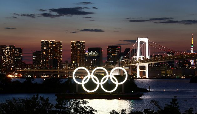The Olympic Rings are seen in front of the skyline during sunset one night ahead of the official opening...