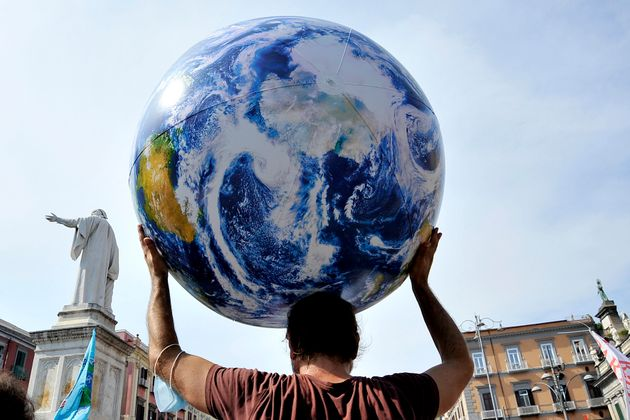 NAPLES, ITALY - 2021/07/22: Protester with a balloon representing the planet Earth, during the demonstration...