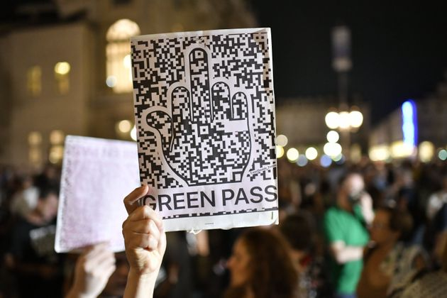 TURIN, ITALY - JULY 22: A demonstrator holds a No Green Pass sign during the No Vax Protest on July 22,...