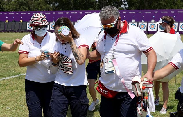 TOKYO, JAPAN - JULY 23: Svetlana Gomboeva of Team ROC is treated for heat exhaustion in the Women's Individual...