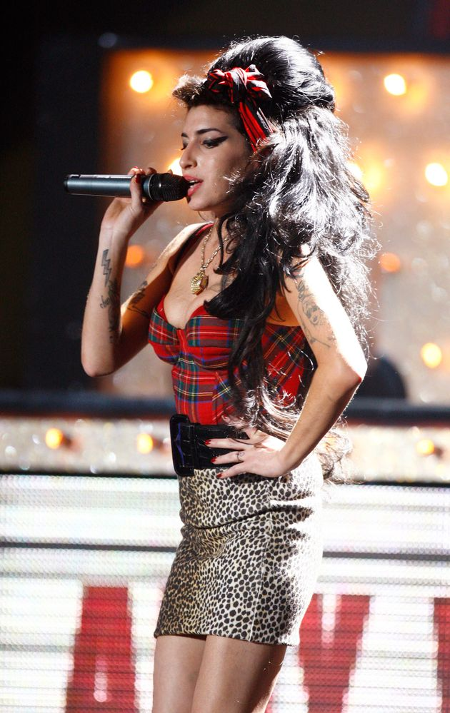 British singer Amy Winehouse performs at the Brit Awards at Earls Court in London February 20, 2008....