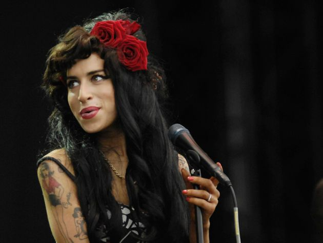 UNITED KINGDOM - AUGUST 16: V FESTIVAL Photo of Amy WINEHOUSE, Amy Winehouse performing on stage (Photo...