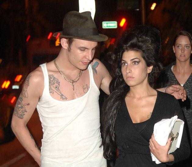 MIAMI BEACH, FL - MAY 16 : Singer Amy Winehouse and fiancee Blake Fielder-Civil walk on Collins Avenue...