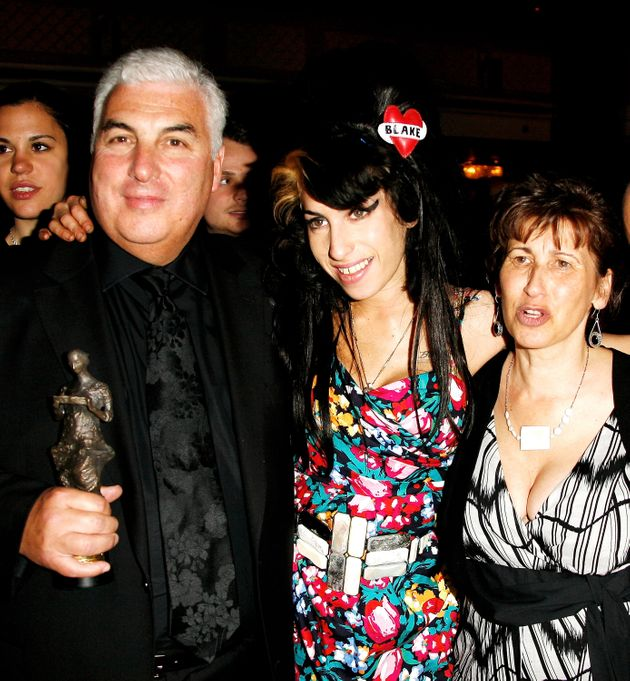 LONDON - MAY 22: (UK TABLOID NEWSPAPERS OUT) Amy Winehouse, her father Mitch and mother Janis pose with...