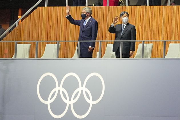 23 July 2021, Japan, Tokio: Olympics: Opening ceremony at the Olympic Stadium. Thomas Bach (l) from Germany,...