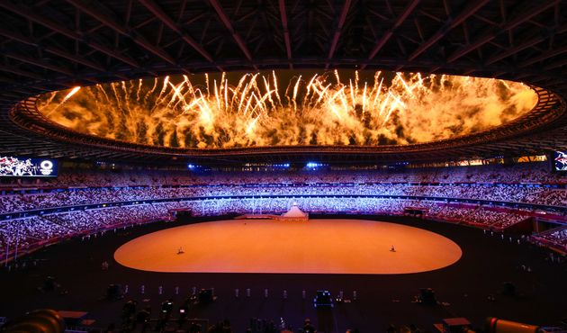 TOKYO, JAPAN JULY 23, 2021: Fireworks go off over the National Stadium at the opening ceremony of the...