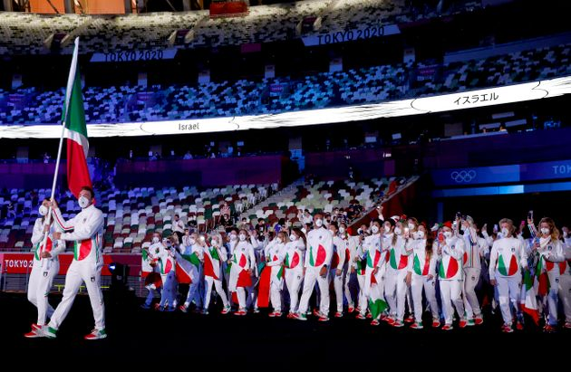 TOKYO, JAPAN - JULY 23: Flag bearers Jessica Rossi and Elia Viviani of Team Italy during the Opening...