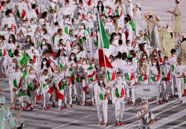 TOKYO, JAPAN - JULY 23: Flag bearers Jessica Rossi and Elia Viviani of Team Italy lead their team in...