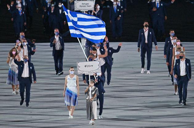 Greece's flag bearer Anna Korakaki and Greece's flag bearer Eleftherios Petrounias and their delegation...