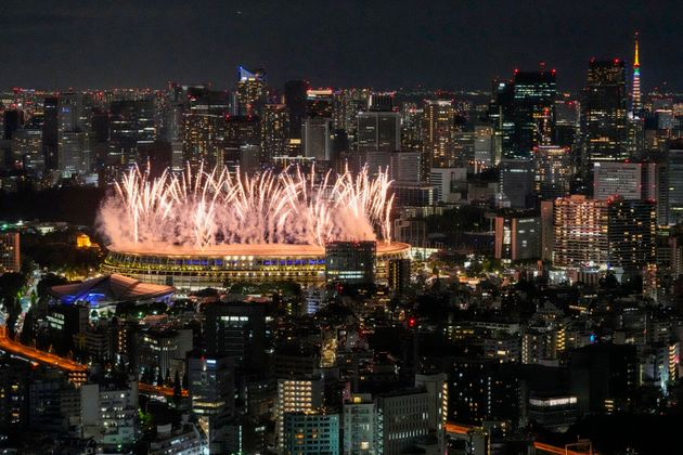 Fireworks illuminate over the National Stadium during the Tokyo Olympics opening ceremony.