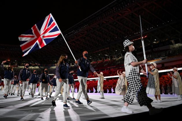 TOKYO, JAPAN - JULY 23: Flag bearers Hannah Mills and Mohamed Sbihi of Team Great Britain leads their...