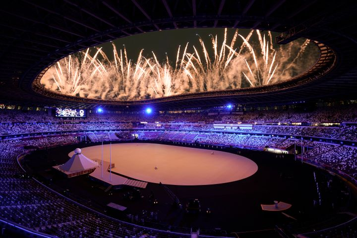 Fireworks go off at the start of the opening ceremony in the Olympic Stadium at the 2020 Summer Olympics, on July 23, 2021, i